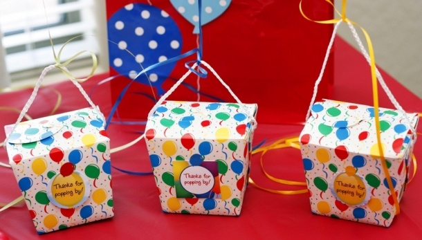 Favor Boxes:  water balloon kit, a helium balloon tied to it, and a Rice Krispie balloon pop, balloon stickers.