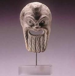 Greek theatre mask. Terracotta. Hellenistic, 3rd/2nd century BC. Height: 14,3cm. Condition: Restored but complete.  Ex. Christos G. Bastis collection. Exhibited at the Metropolitan Museum of Art, 1987, cat. Nr. 78.