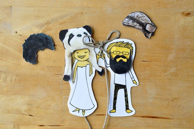 Magnets attached to save the date cards - with interchangeable hats and beards! Cute!