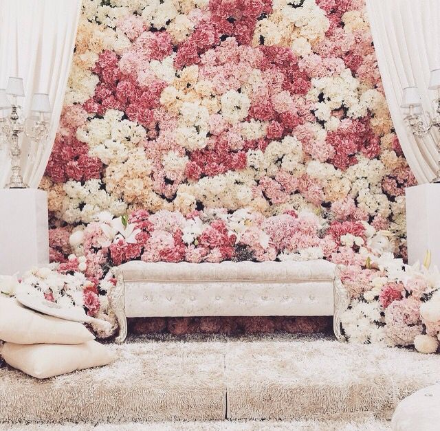 I want this stage set-up, with the flower backdrop, and lace curtains on the side, likewise in the image. I am still deciding if I want initials or something else.