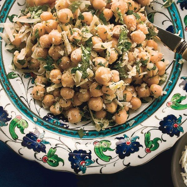 Chickpea salad w lemon, feta/Parmesan, cilantro and shallot. For curried chickpea salad, leave out Parmesan and add curry powder to taste, dried currants, carrots and sliced green onions.