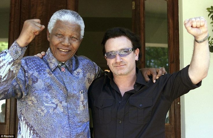 Charity: Former South African President Nelson Mandela (L) and Irish rock star Bono pose together after meeting at Mandela's residence at Houghton in Johannesburg, in this May 25, 2002 photo