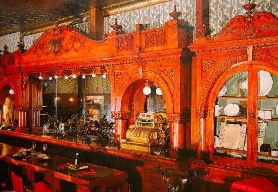 Famous cherry wood bar in The Irma Hotel, Cody, Wyoming, that Buffalo Bill Cody ordered from France. The Irma is a great place to eat &/or stay to get that Old West feeling.