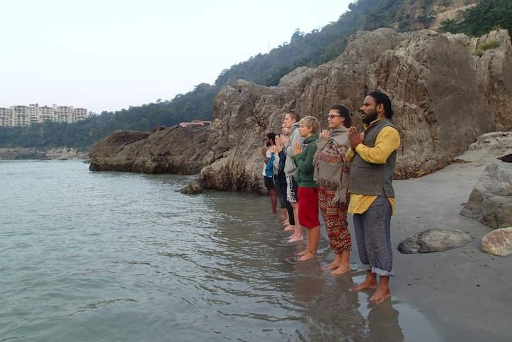 Pranamasana (Prayer Pose)  Greeting Ma Ganga (The Ganges River) with the rising sun during our morning meditation class is Rishikesh, India www.sushilyoga.com
