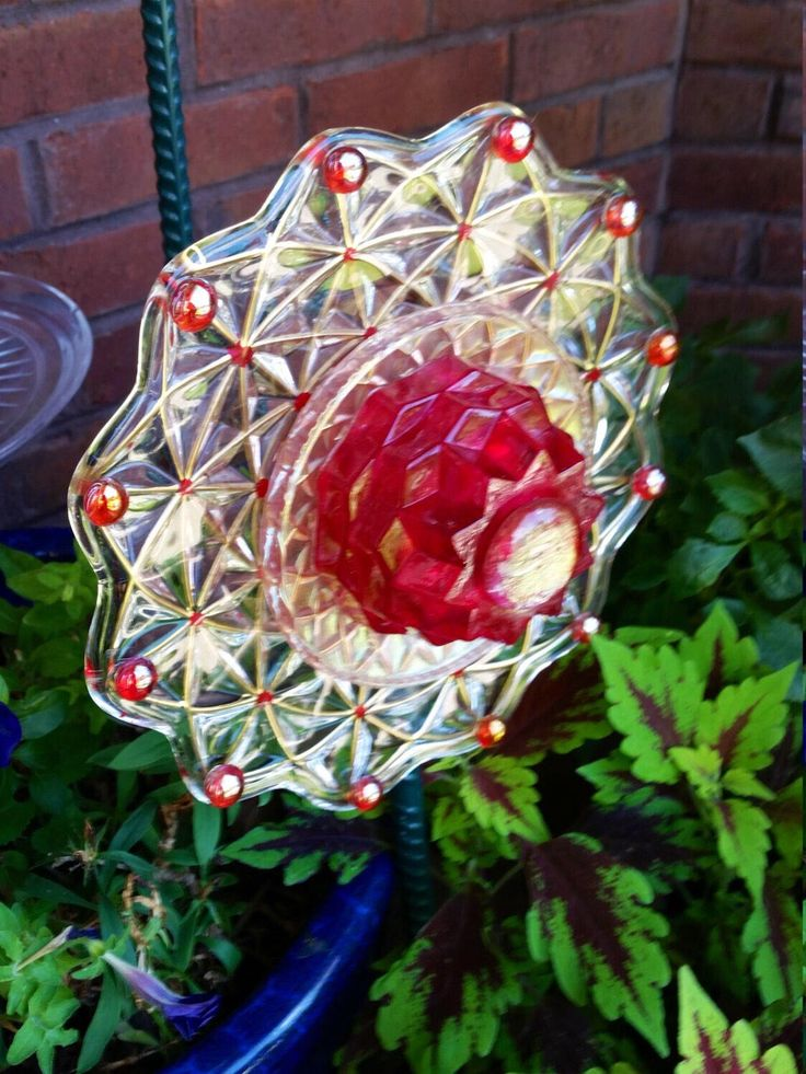Golden Web with Ruby Center Glass Flower by TiggyGlass on Etsy https://www.etsy.com/listing/270026036/golden-web-with-ruby-center-glass-flower