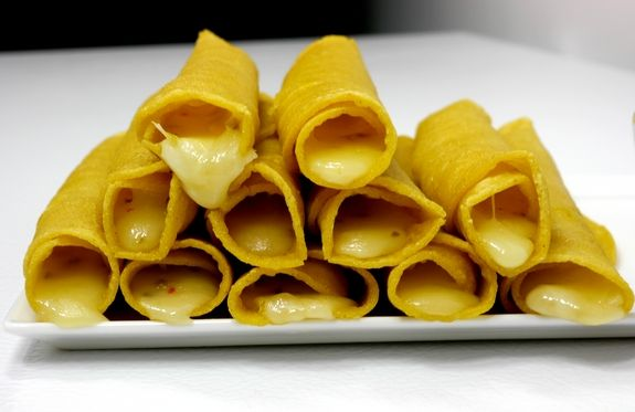 Smokey Soft Taco Roll Ups with Avocado Garlic Dipping Sauce a stack of goodness