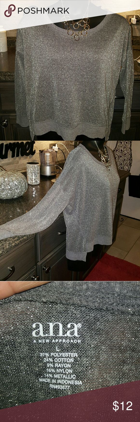 Shimmery metallic silver blouse. This blouse was worn a few times. Euc. Great with some black slack or black capris and some heels or cute flats. Ana Tops Blouses