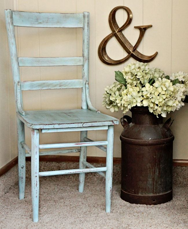 Love this look with the chair, the hydrangea-filled milkcan, and the ampersand. I am stealing this idea for my porch!!!