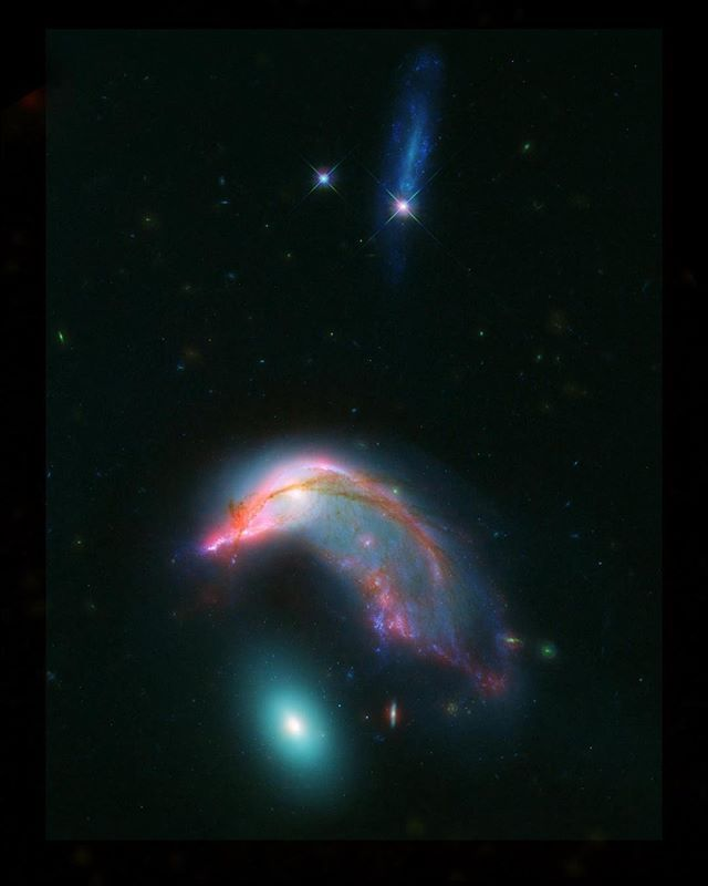 "nasa Distant interacting galaxies – located 23 million light-years away – bear an uncanny resemblance to a penguin guarding an egg.  The ""penguin"" part of the pair was probably once a relatively normal-looking spiral galaxy, flattened like a pancake with smoothly symmetric spiral arms. Rich with newly-formed hot stars, seen in visible light as bluish filaments, its shape has now been twisted and distorted as it responds to the gravitational tugs of its neighbor.  The ""egg"" of the pair is…"