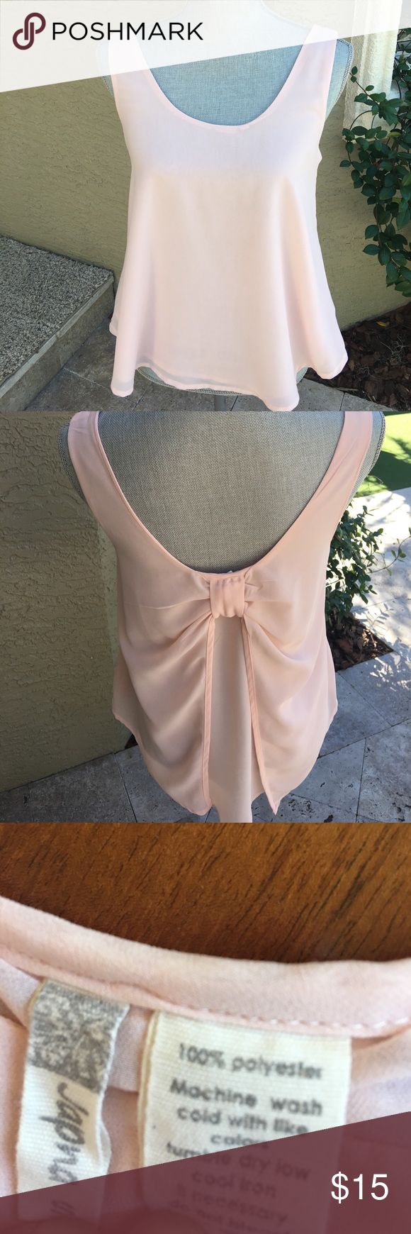 Ladies peach top. Ladies peach top with bow at low back!  Peach in color. 100% polyester. Japna Tops Camisoles