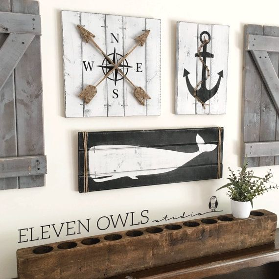 This is a SET OF THREE nautical art pieces - an anchor, a compass, and a whale, each with jute rope accents for a truly nautical effect! Rustic beach house decor is perfect for a nursery, bedroom, bathroom, beach house or anywhere a little fun is needed! And, you can choose your own color scheme! The anchor is on 14 x 9.5 wood canvas, the compass is on a 14 x 14 wood canvas and the whale is on a 24 x 8.5 wood canvas. All are ready to hang with hanging wire already attached. Please Note: The…