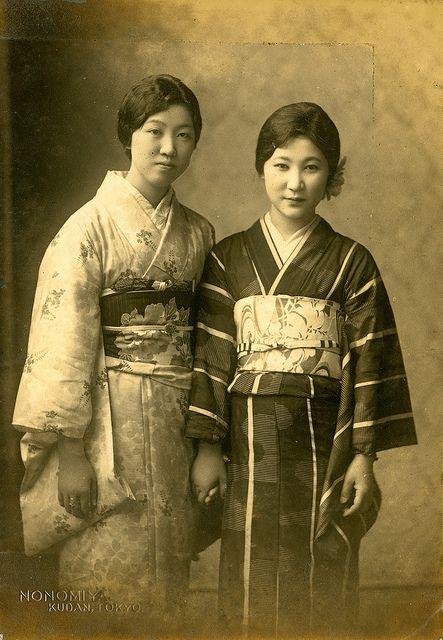 "Vintage photo of two women in kimono. The photo is stamped ""Nonomiya Kudan Tokyo"". Pre WWII"