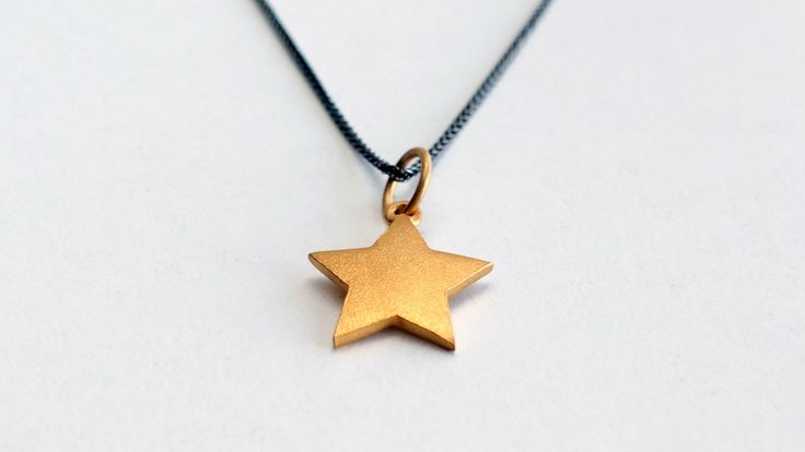 Necklace from Black Chain with a star gold plated with mat surface -Price:21€