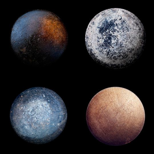 """The bottom of some well-used frying pans, looking very much like planets. Reminds me of Wm Blake's """"To see the world in a grain of sand."""""""