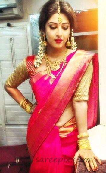 Serial actress Sonarika Bhadoria bridal look in saree. She looks amazing in silk saree. Neck jewelry, flowers in head and bangles finished her beautiful lo