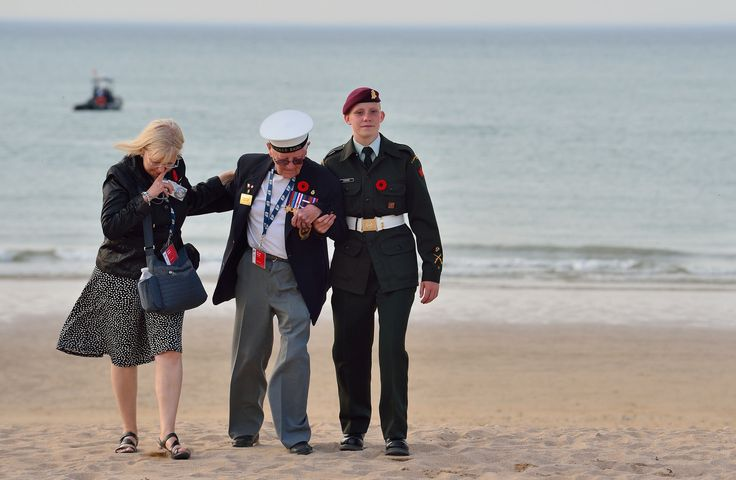 A veteran walks on Juno beach, in Courseulles-sur-Mer, France, shortly after the 70th Anniversary of D-Day and the Battle of Normandy ceremony on June 6, 2014.   Photo: MCpl Marc-Andre Gaudreault, Canadian Forces Combat Camera
