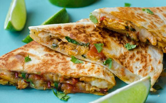 Chipotle Chicken Quesadillas - Warm and crisp flour tortillas filled with gooey melted cheddar, shredded chicken and a smoky tomato-chipotle sauce