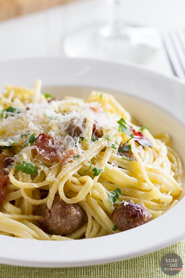 A traditional carbonara pasta is combined with sausage and bacon in this indulgent Sausage Carbonara Pasta.