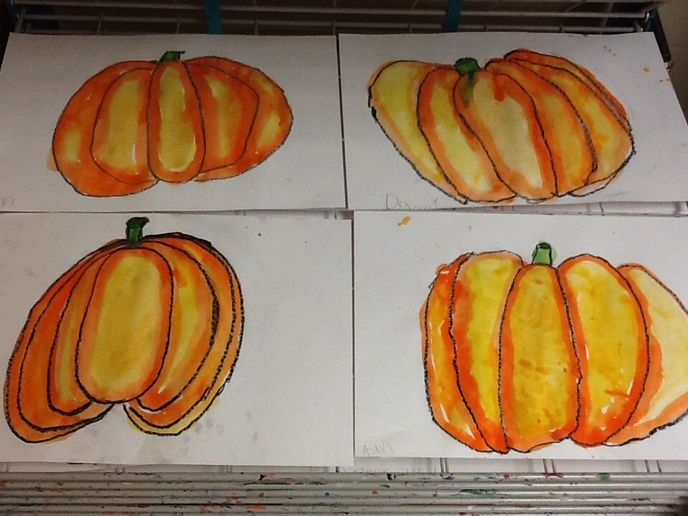 Our pumpkins are really popping off the page in first grade. We looked at my finished example and saw that I painted my orange pumpkin with two colors, orange & yellow. Why? Well many of my first...