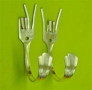 silverware art.  Cute idea to hang the dreaded kitchen towel on...
