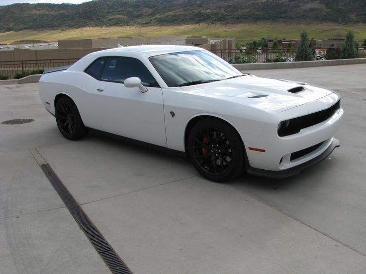 2015 Dodge Challenger Hellcat, 707 Hp., White/Black Leather Interior, Heated Front Seats, Leather Seats, Ventilated Front Seats, Steering Wheel Mounted Audio Controls, Functional Hood Scoop, Brembo Red Brake Calipers, 20-in x 9.5-in SRT Matte Black Forged Wheels, Universal Garage Door Opener, Only 7 Miles, Asking Only $75,900.00. Contact me at MichelineGould.WestCoast@gmail.com