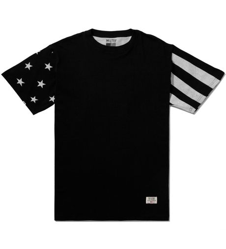 Mister Black/White Print Mr. USA Summer Blend Tee $38.00 USD.    This summer poly cotton-blended tee made in San Francisco is made with stars and striped sleeves adorned with the USA flag print all over. Mr. Independence comes in Black/White print, subtly delivering detail into a daily look.