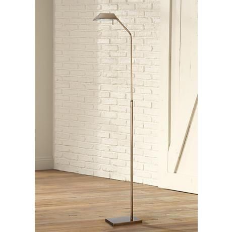 This antique brass floor lamp has clean, minimal lines and an enduring design.
