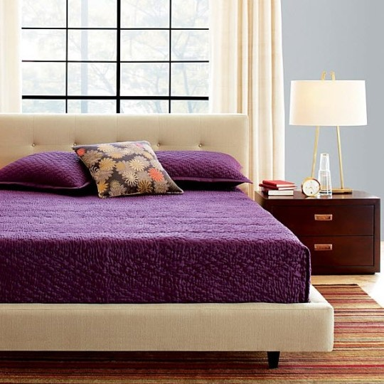 I love the bed and the purple color of the bedspread