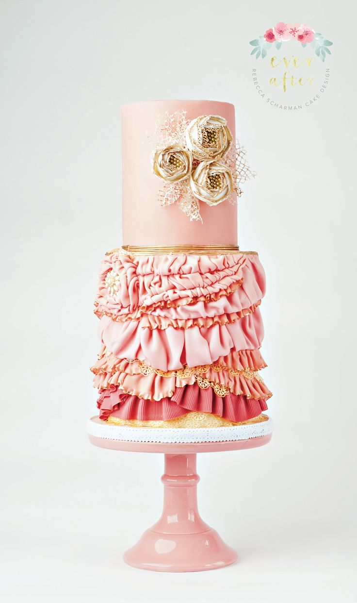 @everaftercake Pink Flapper Cake - Double barrel tiers. Rows upon rows of various types of ruffles and pleats. The sugar flowers are outlined in lace with some russian netting to bring them all together.