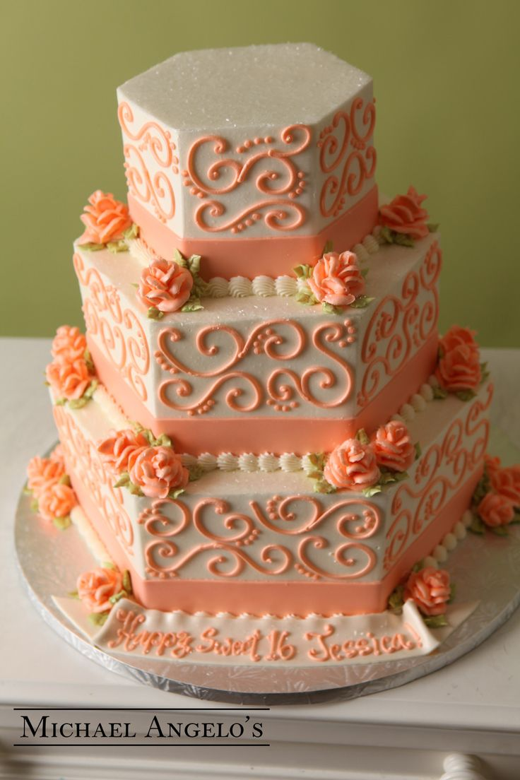 Peach Swirl #63Ribbons This design is hexagon-shaped with swirls and flowers along the sides of each layer. Any color ribbon or swirls can be placed on the cake to match your wedding. Gum paste flowers make a great topper and the fondant ribbon is a perfect way to had a short message for the bride and groom.