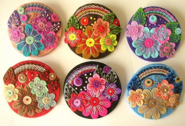 Felt flower brooches in rainbow order