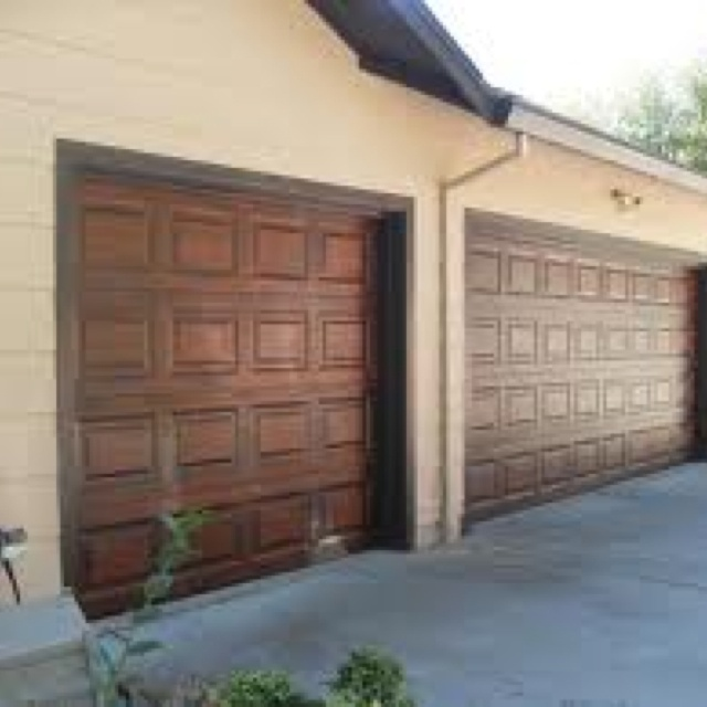 Garage door makeover by applying a finishing technique for Garage door colors