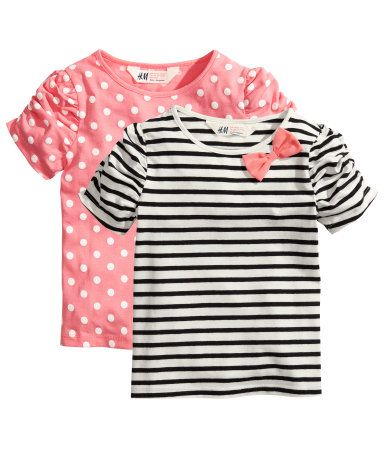 Little girl style: pink polka dot t shirt and black and white striped t shirt with pink bow detail from H and M.