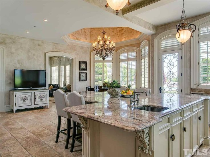 Traditional Kitchen with Kitchen island, Chandelier, Flush, Faux finish paint, Undermount sink, Complex granite counters
