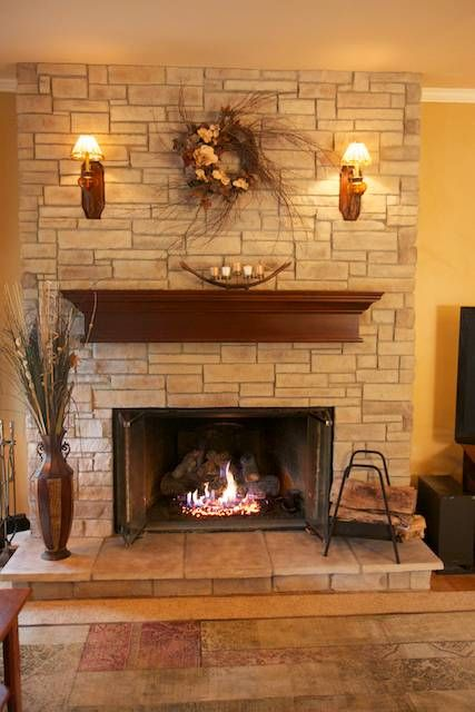 This faux or manufactured stone can dress up a brick fireplace that needs a refacing and works