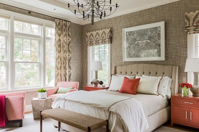 This sophisticated bedroom gets a nice punch of color via furniture and decorative accessories in happy shades of coral. Because the coral elements are spread throughout the room, it doesn't feel overly colorful, and your eye is able to move about the space, taking it all in. Additionally, the white elements in the room keep the taupey-tan hues from looking too muddy.