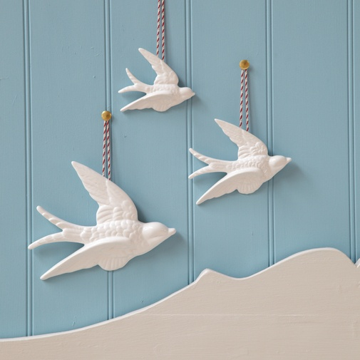 Three WhiteSwallows