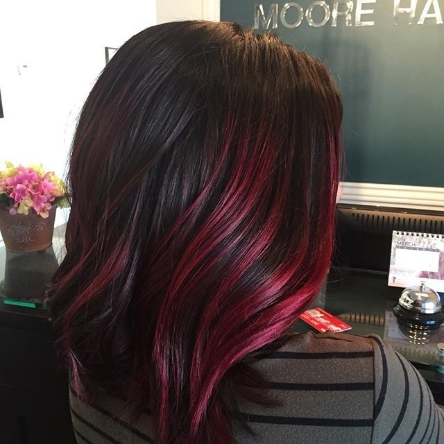 Loving this shiny red violet highlight by our own Kim at @moore_hairdesign