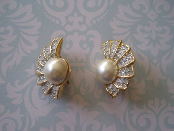 US$12.00 plus shipping!  https://www.etsy.com/ca/listing/209462512/vintage-butler-faux-pearl-and-rhinestone?ref=shop_home_active_18