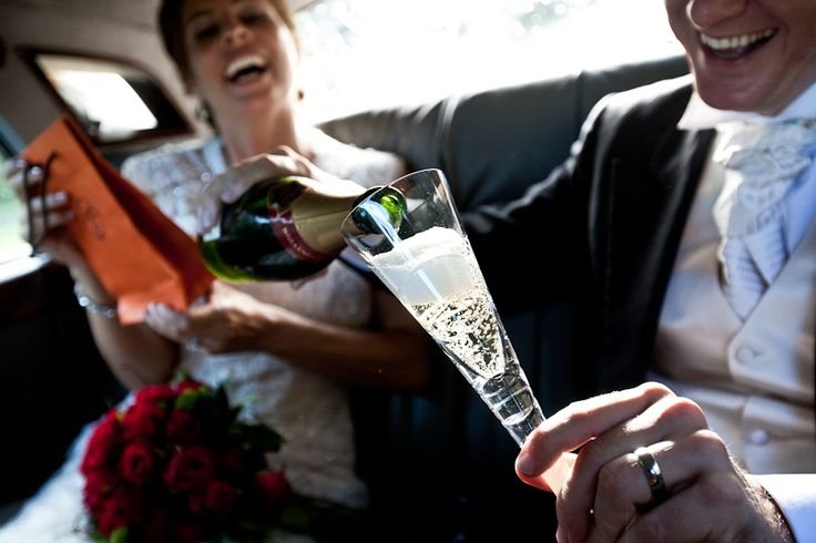 Champagne in the Rolls by DKS Weddings