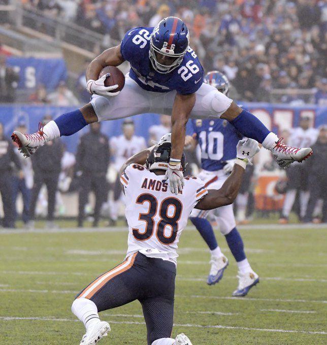 Saquon Barkley hurdles a Chicago Bears defender NYG Nfl