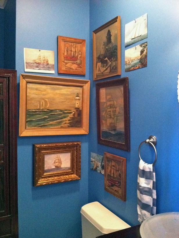 Deep blue walls, vintage landscape paintings in bathroom by Anisa Darnell, Designers' Portfolio 5790 : HGTV