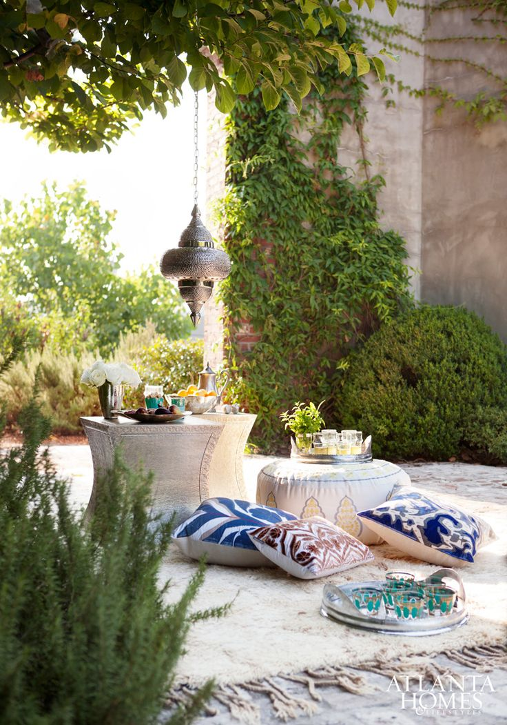 Back home in Atlanta, Webb created an environment that captures the magic of Marrakech by using products from Atlanta shops and showrooms. Rug, Sullivan Fine Rugs. Souk tables and Tangiers pendant by Currey & Company. Upholstered pouf, Bee. Pillows, Gramercy Fine Linens & Furnishings. Photographed on location in the courtyard of Summerour Architects.