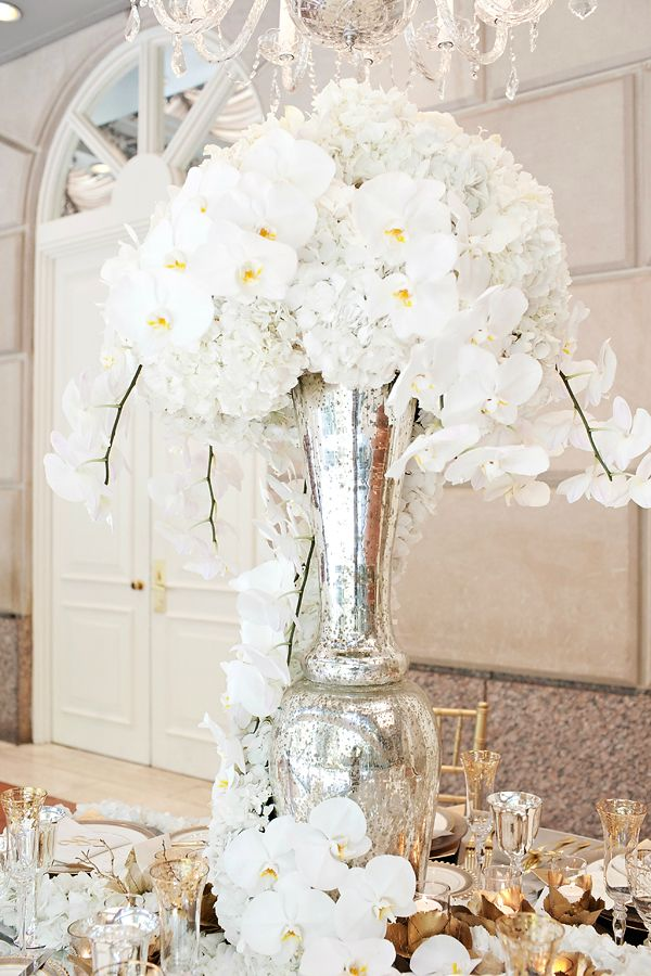 I had a white orchid bouquet and my wedding and also white orchids on my tables and cake...so simple and classic