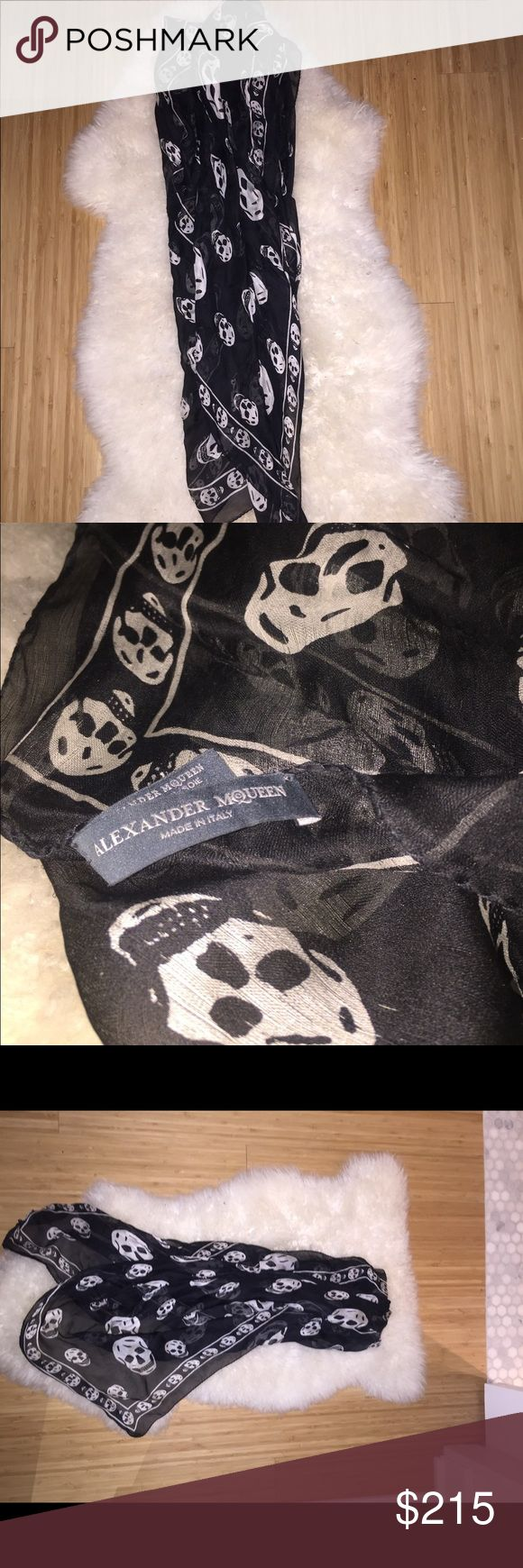 Alexander McQueen Skull Scarf 100% Authentic Alexander McQueen black scarf with white skulls. Gently used, pre-owned. Alexander McQueen Accessories Scarves & Wraps