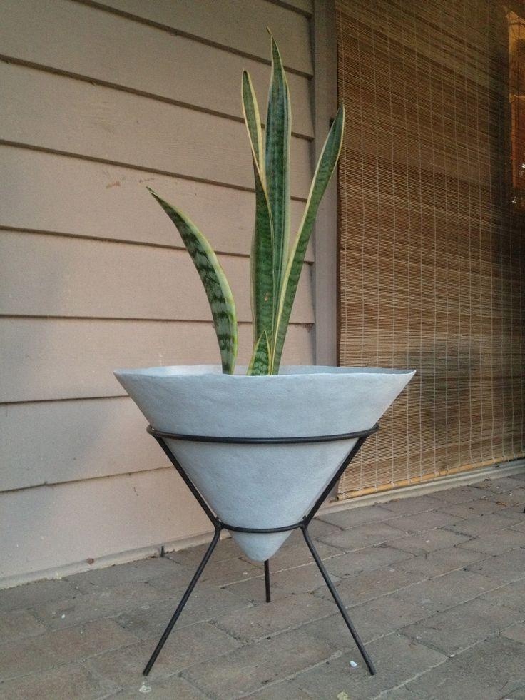 Kurrlson mid century style fibreglass/cement cone planter on custom tripod frame