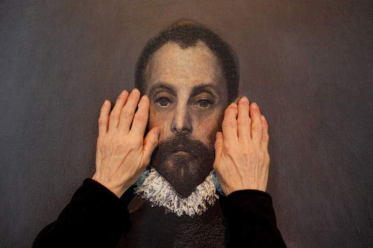 Feb. 10, 2015. A blind person feels a copy of 'The gentleman with his hand on his chest' of El Greco with her hands at The Prado Museum in Madrid. <i>Hoy toca el Prado</i> (Touch The Prado) allows blind or vision-impaired visitors to explore with their hands the copies of six masterworks. The copies were created using a technique called Didu which provides texture and volume to the paintings.