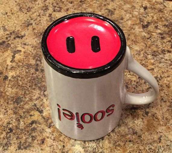 Hand painted Razorbacks mug. Sooie! Painted on the side with red enamel. Pig snout appears on bottom when drinking. Very funny