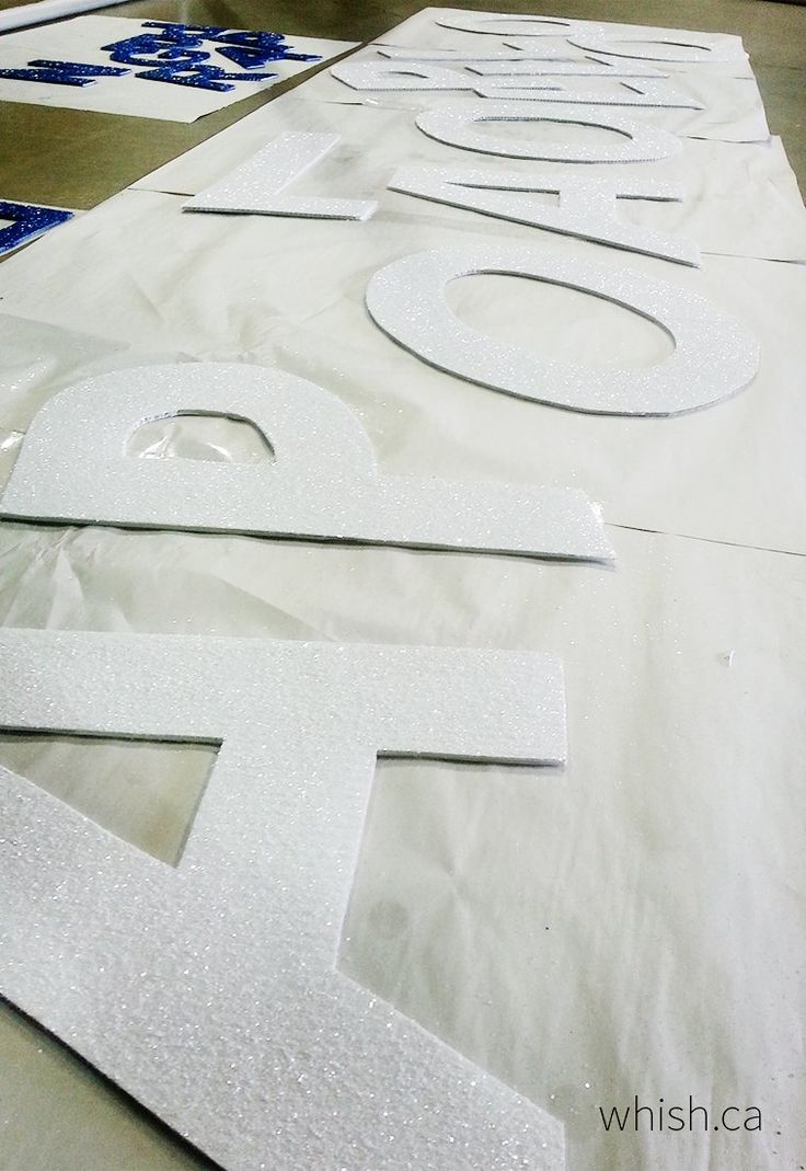 Glittered letters for a parade float | Whish.ca