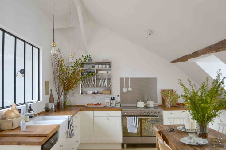 Stylist/blogger Lucille Gauthier-Braud lives in in the middle of Paris, but her newly overhauled kitchen looks straight out of the French countryside. We've sourced all of the design elements for you to create your own version.
